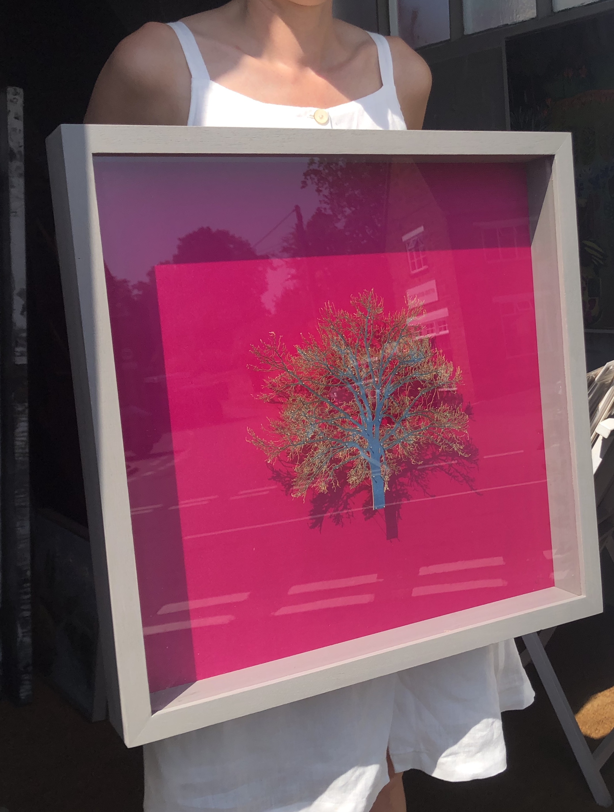 Emma Levine art for sale. Hot pink background with bright green tree sculpture set in deep frame.