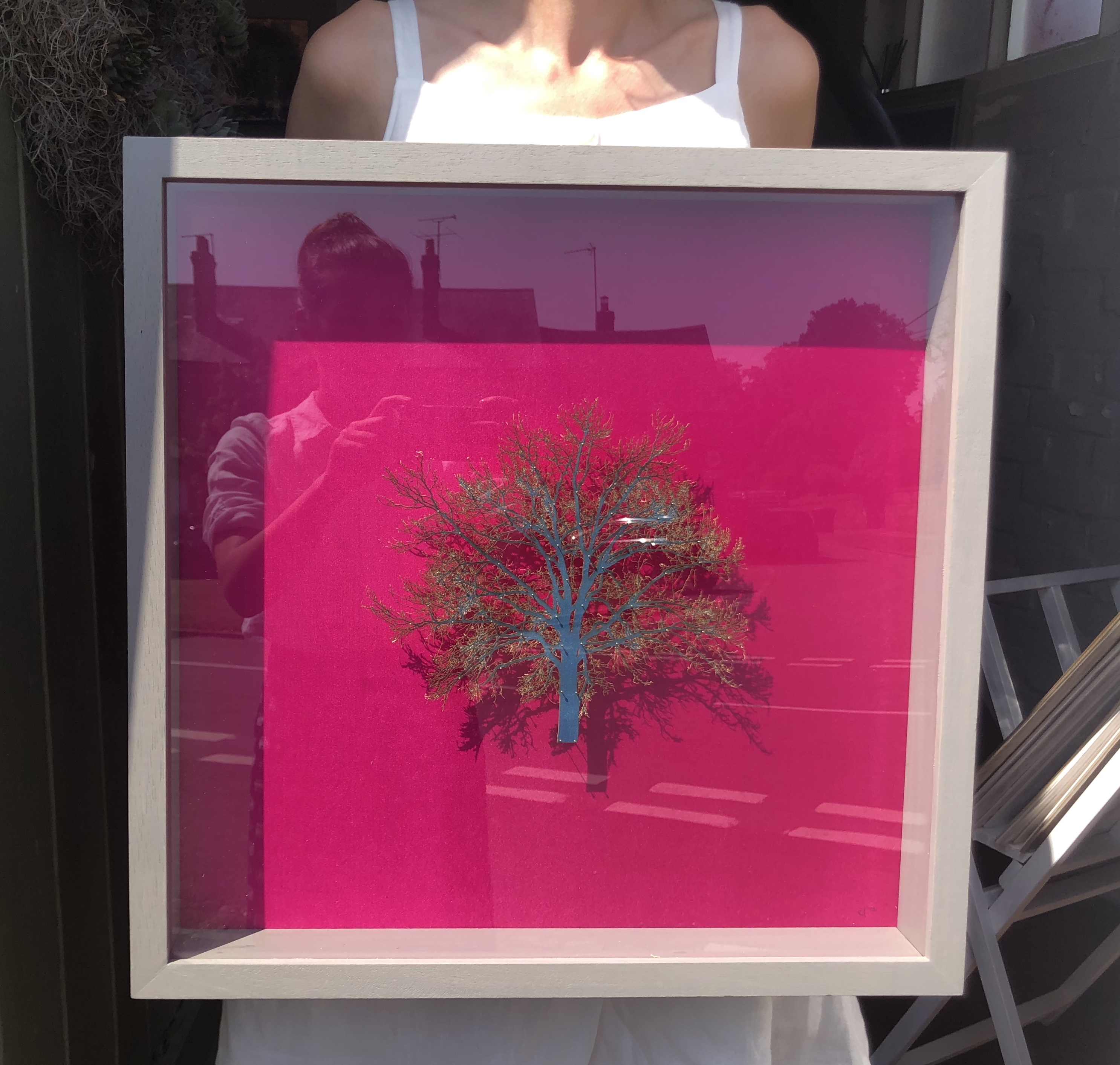 Emma Levine art for sale. Hot pink background with bright green tree sculpture framed and scaled.