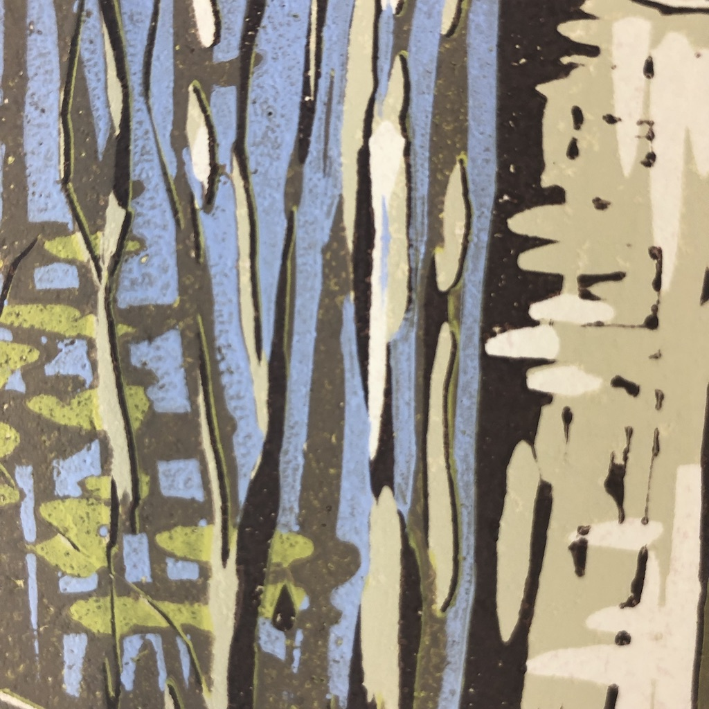 A reduction linocut of a beech wood before the leaves and bluebells appear.