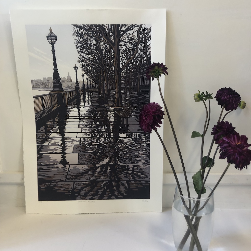 Alexandra Buckle's Southbank Puddles is a limited edition linocut print depicting a cityscape of London's famous Southbank.