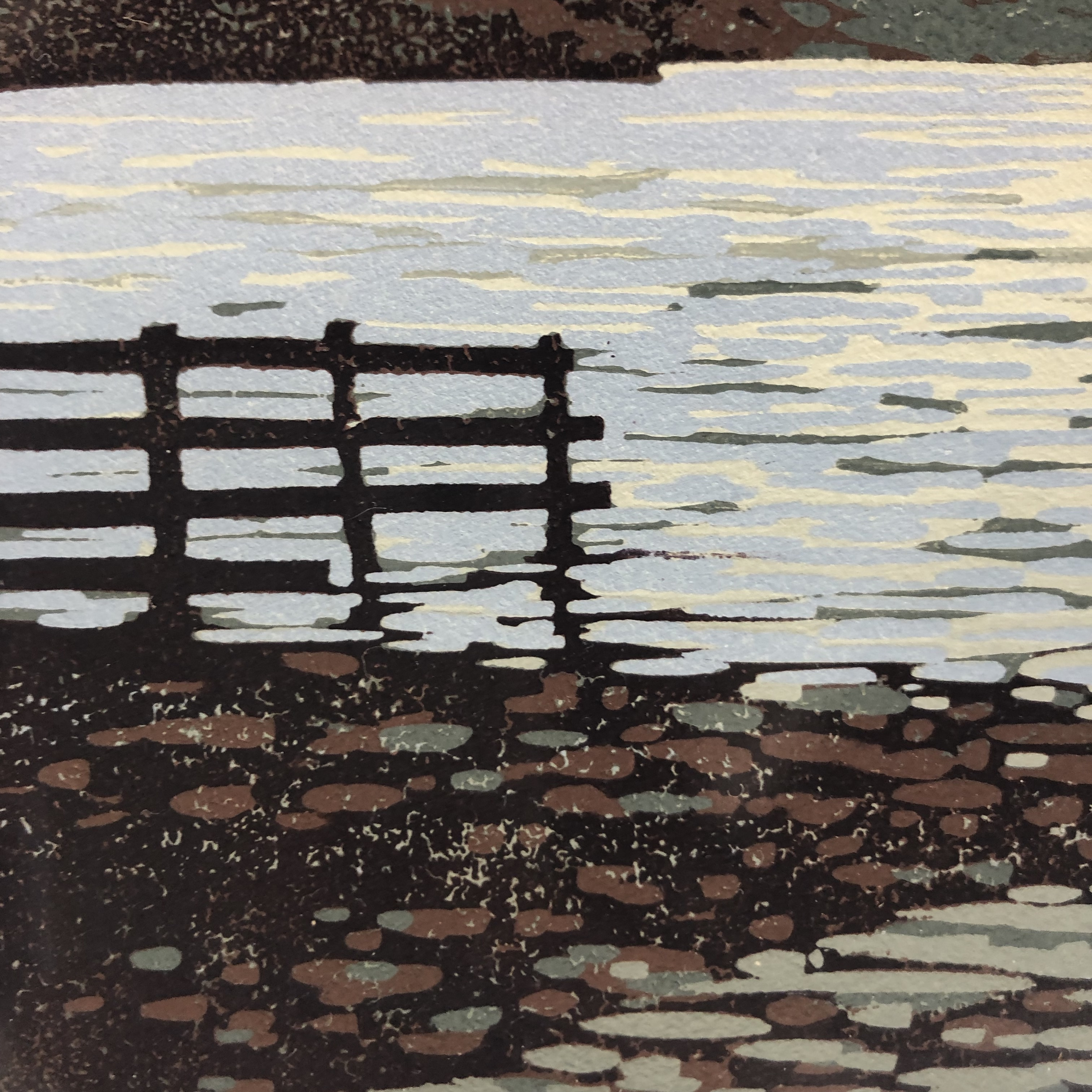 A reduction linocut of a view across Grasmere in the Lake District.