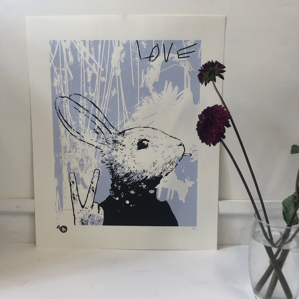 Harry Bunce's Green Fingers Paper is a limited edition silkscreen print. The piece depicts a rebellious rabbit and is printed in light blue, black and white.