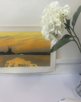 Cley Twighlight is a limited edition 3 block linocut print. The piece depicts a rural landscape at dusk and features the outline of the quaint Cley Windmill.
