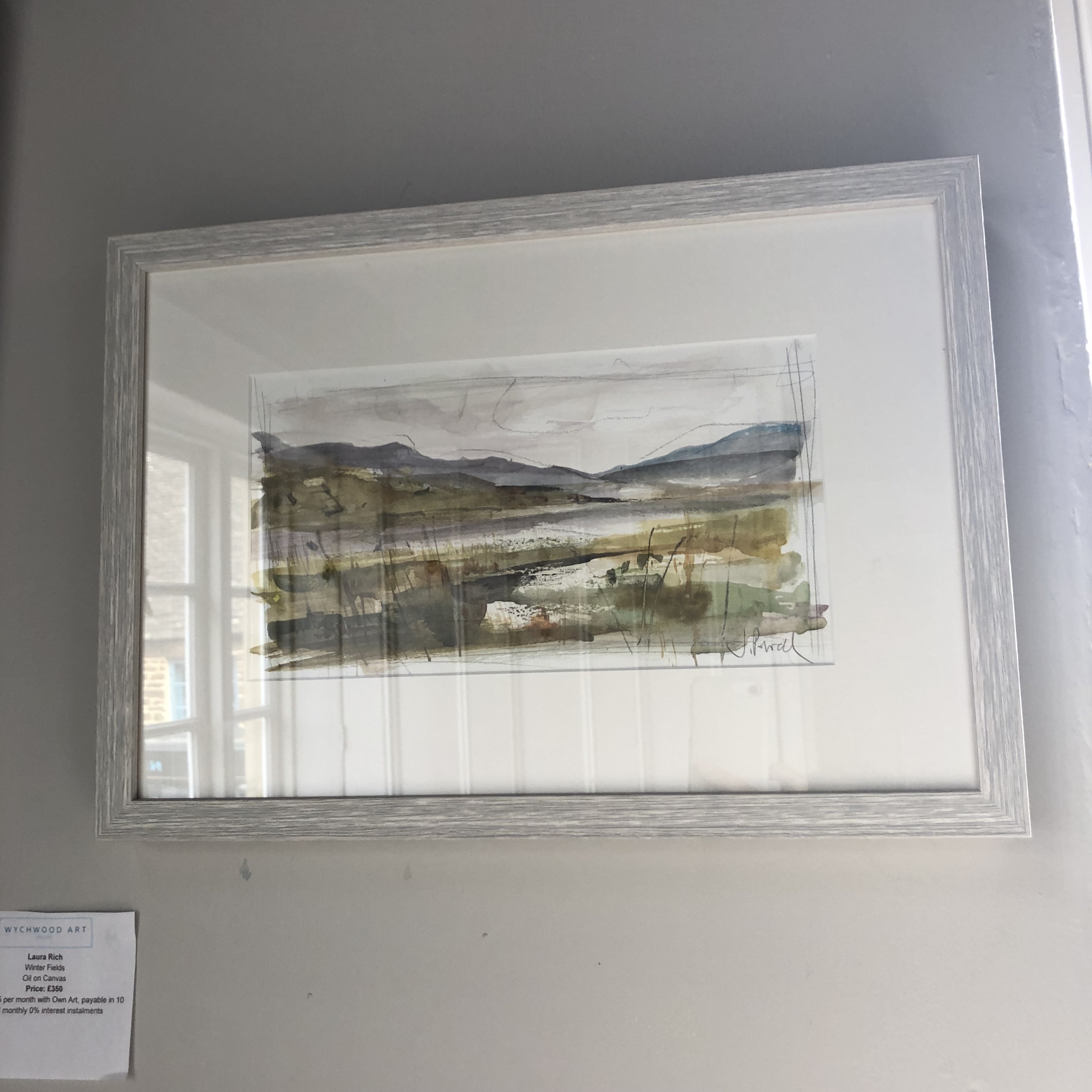 This piece depicts a loch nestled in the undulating Scottish landscape.